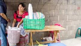 La venta de comida típica de Doña Ana mejoró gracias a estudiantes de la Universidad de San Carlos. (Foto: The Real Briefing Project)
