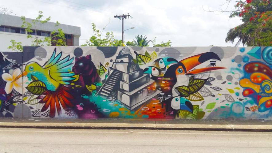 Guatemaltecos pintan murales artísticos en Santa Elena