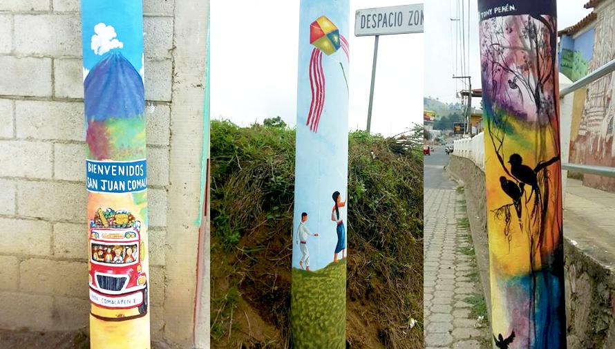 Guatemaltecos pintan postes en San Juan Comalapa, Chimaltenango
