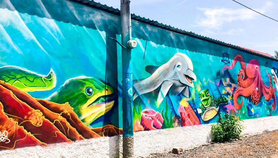 Artistas guatemaltecos realizaron murales coloridos en El Paredón, Escuintla