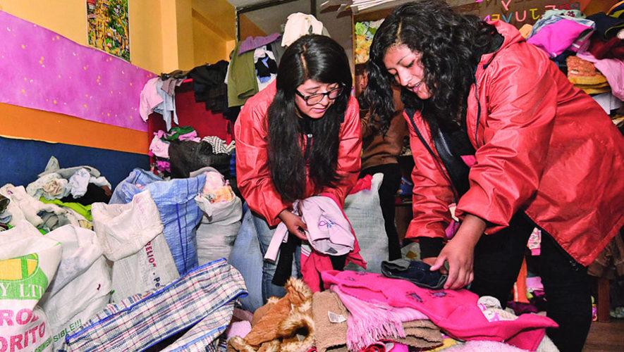 Voluntariado para entregar ropa a personas de escasos recursos | Diciembre 2018